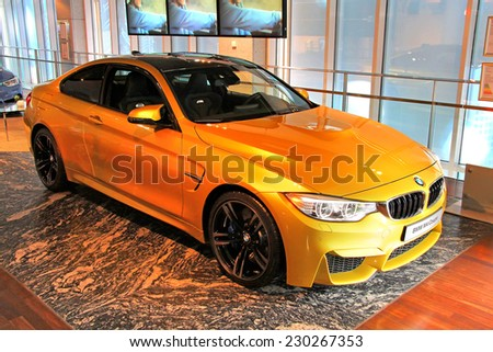 BERLIN, GERMANY - AUGUST 16, 2014: Brand new sports car BMW F82 M4 Coupe in the showroom of the BMW Haus am Kurfuerstendamm. - stock photo