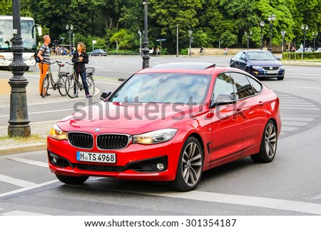 BERLIN, GERMANY - AUGUST 15, 2014: Modern red car BMW F34 3-series GT at the city street. - stock photo