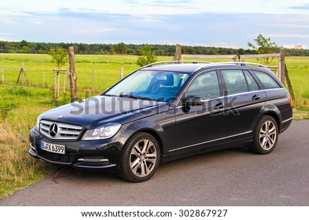 BERLIN, GERMANY - AUGUST 16, 2014: Motor car Mercedes-Benz W204 C180 at the suburban road. - stock photo
