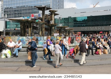 BERLIN, GERMANY - AUGUST 26, 2014: People visit famous Alexander Square (Alexanderplatz) in Berlin. Berlin is Germany's largest city with population of 3.5 million. - stock photo