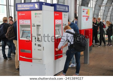 BERLIN, GERMANY - AUGUST 26, 2014: People wait at Alexanderplatz railway station in Berlin. The station dates back to 1882 and is one of 11 stations in Berlin that have long distance connections. - stock photo