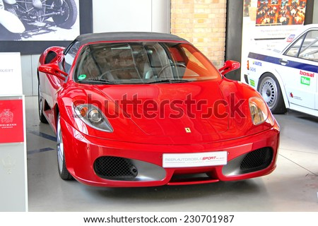 BERLIN, GERMANY - AUGUST 12, 2014: Red italian sports car Ferrari F430 Spider in the museum of vintage cars Classic Remise. - stock photo