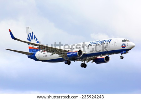BERLIN, GERMANY - AUGUST 17, 2014: SunExpress Boeing 737 arrives to the Tegel International Airport. - stock photo