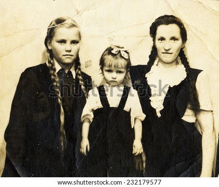 BERLIN, GERMANY - CIRCA 1935: antique portrait of mother with children wearing vintage clothing, circa 1935 in Berlin, Germany  - stock photo