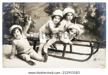 BERLIN, GERMANY - CIRCA 1910: old photo of kids with sledge. nostalgic vintage christmas picture - stock photo