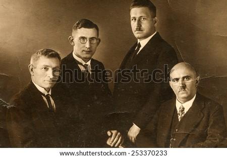 BERLIN, GERMANY, CIRCA 1930's: Vintage photo of four elegant men - stock photo