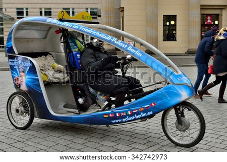 BERLIN, GERMANY-DECEMBER 23, 2014: Velo rickshaw on the street in Berlin - stock photo