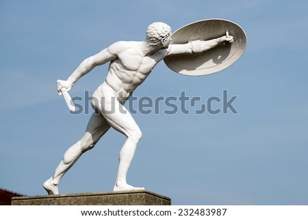 BERLIN, GERMANY/EUROPE - SEPTEMBER 15 : Statue of a naked male warrior at the Charlottenburg Palace in Berlin Germany on September 15, 2014 - stock photo