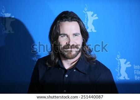BERLIN, GERMANY - FEBRUARY 08: Actor Christian Bale poses during the photocall of 'Knight of Cups' within the 65th Berlin Film Festival in Berlin, Germany on February 08, 2015. - stock photo