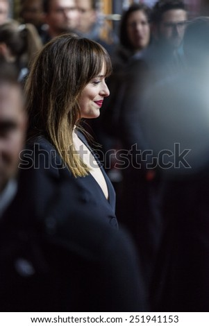 BERLIN, GERMANY - FEBRUARY 11: Actress Dakota Johnson attends the 'Fifty Shades of Grey' premiere during the 65th Berlinale International Film Festival at Zoo Palast on February 11, 2015 - stock photo