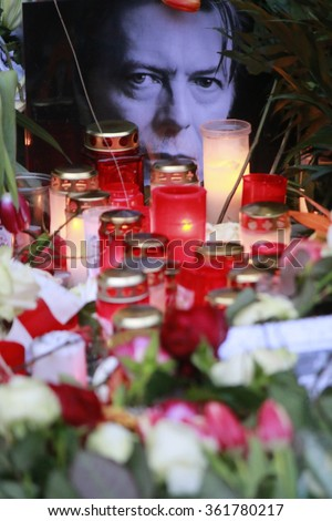 BERLIN, GERMANY - JANUARY 11, 2016: Mourning for the deceased pop star David Bowie in front of the house in the Hauptstrasse in Berlin-Schoeneberg in which he lived in the 1970s. - stock photo