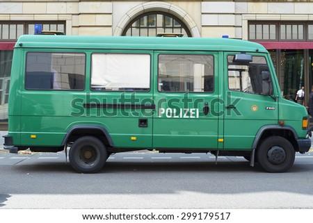 BERLIN, GERMANY - JULY 08: Empty green police van parked in the street. July 08, 2015 in Berlin. - stock photo