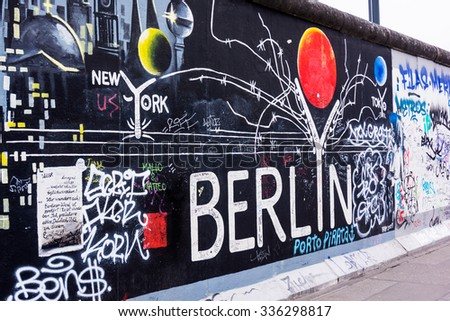 BERLIN, GERMANY - MARCH 20: Berlin Wall graffiti seen on March 22, 2015, Berlin, East Side Gallery. It's a 1.3 km long part of original Berlin Wall which collapsed in 1989 - stock photo
