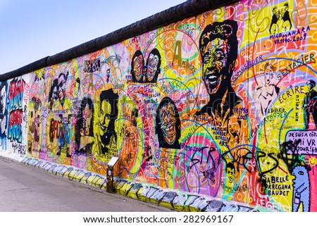 BERLIN, GERMANY - MARCH 20: Graffiti at the East Side Gallery on March 20, 2015 in Berlin, Germany. The East Side Gallery is the longest preserved stretch of the Berlin wall. - stock photo