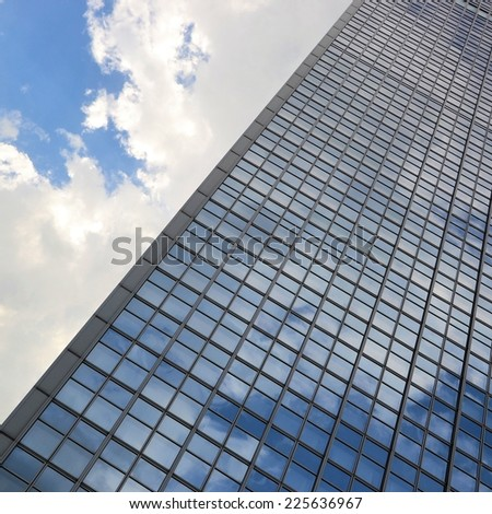 "BERLIN, GERMANY May 17, 2013: Detail of the glass facade of the hotel ""Park Inn"" at Alexanderplatz in Berlin - stock photo"