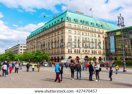 Berlin, Germany - May 14, 2016: Hotel Adlon Kempinski with unidentified people. Its a luxury hotel on Unter den Linden, at the corner with Pariser Platz, directly opposite the Brandenburg Gate - stock photo