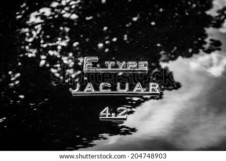 BERLIN, GERMANY - MAY 17, 2014: The emblem on the trunk of the sports car Jaguar E-Type 4.2. Black and white. 27th Oldtimer Day Berlin - Brandenburg  - stock photo