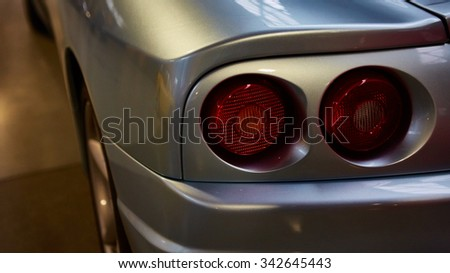Berlin, Germany - November 15, 2015: Detail of classic car. Closeup of the tail lights of a classic car of the museum of vintage cars - stock photo