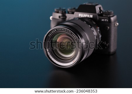 BERLIN, GERMANY - OCT. 25, 2014:Fujifilm X-T1 Mirrorless Digital Camera on black background. - stock photo