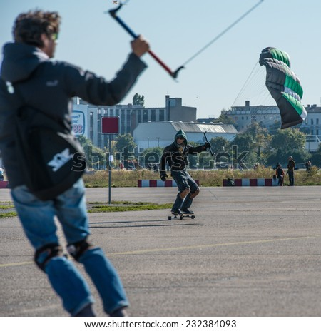 BERLIN, GERMANY - OCTOBER 3, 2013: Skaters on the Tempelhof Airport - stock photo