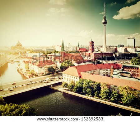 Berlin, Germany rooftop view on Television Tower, Berlin Cathedral, Rotes Rathau and the River Spree. Major landmarks retro, vintage style. - stock photo