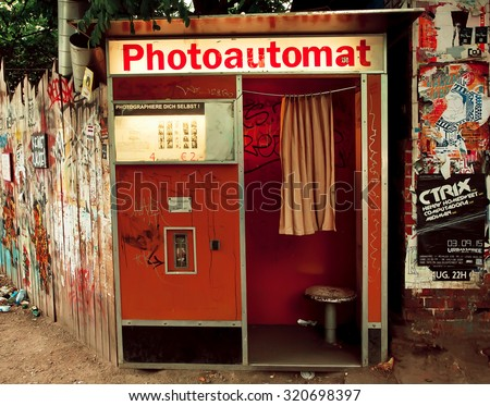 BERLIN, GERMANY - SEP 4: Common attraction in Berlin - Photo Automat - on the dirty street on September 4, 2015. Urban area of Berlin comprised about 4 million people making it 7th most populous in EU - stock photo