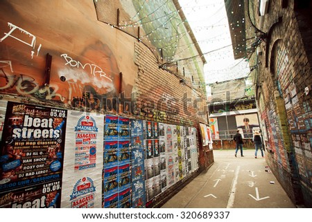 BERLIN, GERMANY - SEP 4: Popular grunge area Friedrichshain with arts and underground clubs on September 4, 2015. Urban area of Berlin comprised about 4 million people, the 7th most populous in EU - stock photo