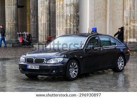 BERLIN, GERMANY - SEPTEMBER 11, 2013: Black premium car BMW E66 7-series at the city street. - stock photo