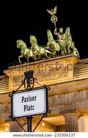 BERLIN - GERMANY - September 29, 2014. Close-up on Quadriga located on top of Brandenburg Gate in Berlin, Bermany. Night picture of Quadriga with dark, black sky. Berlin, Germany, September 29, 2014 - stock photo