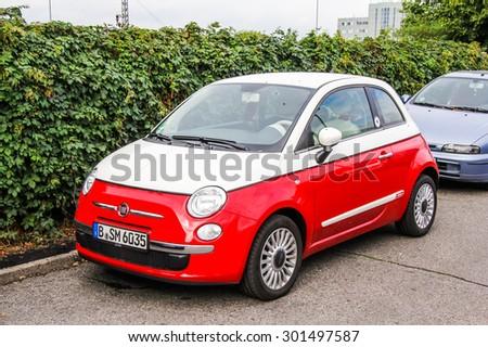 BERLIN, GERMANY - SEPTEMBER 11, 2013: Motor car Fiat 500 at the city street. - stock photo