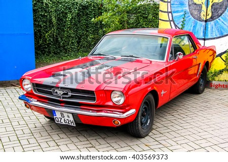 BERLIN, GERMANY - SEPTEMBER 12, 2013: Motor car Ford Mustang in the city street. - stock photo