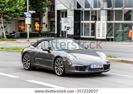 BERLIN, GERMANY - SEPTEMBER 12, 2013: Motor car Porsche 991 911 in the city street. - stock photo