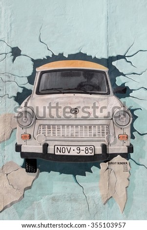 Berlin, Germany - September 9, 2014: Painting from Birgit Kinder of a Trabant in The East Side Gallery, Berlin Wall - stock photo