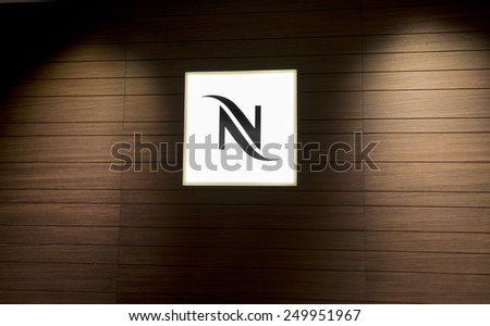 "BERLIN, GERMANY - SEPTEMBER 6: the logo of the brand ""Nespresso"" at the Nespresso Store in Berlin. Berlin, Germany, Europe sept 6 2014 - stock photo"