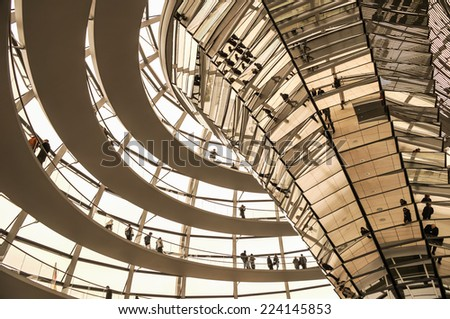 BERLIN, GERMANY - SEPTEMBER 20: View of Reichstag dome on September 20, 2013 in Berlin, Germany. The Reichstag dome is a glass dome constructed on top of the rebuilt Reichstag building. - stock photo
