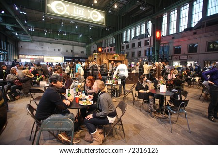 BERLIN - JANUARY 21: Restaurant area at Bread & Butter fair on January 21, 2011 in Berlin, Germany. Tens of thousands of visitors attended the tradeshow this year. - stock photo