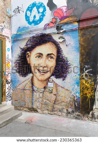 BERLIN - JULY 28, 2014: Mural of anne frank. Anne Frank  was a German origin Jewish girl who is known for the diary she wrote during World War II, when she was hiding in Amsterdam. - stock photo