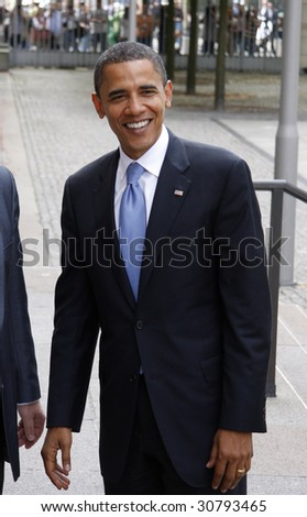 BERLIN - JULY 24: Presidential candidate Barack Obama smiles before a meeting with German Foreign Minister in the courtyard of the German Foreign Ministry July 24, 2008 in Berlin. - stock photo