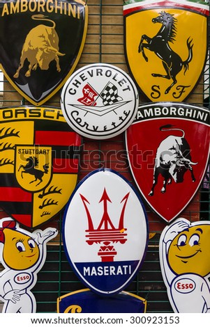 BERLIN - JUNE 14, 2015: Background of various emblems of various car brands producing sports cars. The Classic Days on Kurfuerstendamm. - stock photo