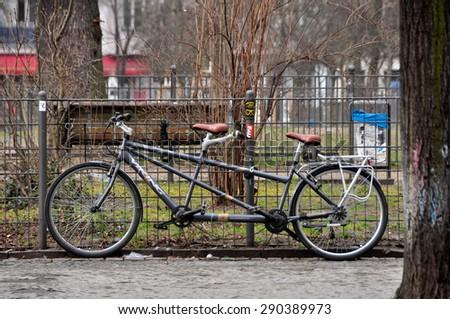 BERLIN MARCH 6: Double bike (over 15% people in Berlin prefer moving by bike) on March 6, 2015. - stock photo