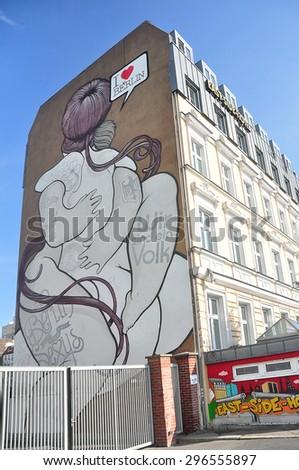 BERLIN MARCH 6: Graffiti House in Easten Berlin (Berlin is the most popular city among graffiti artists) on March 6, 2015 in Berlin. - stock photo