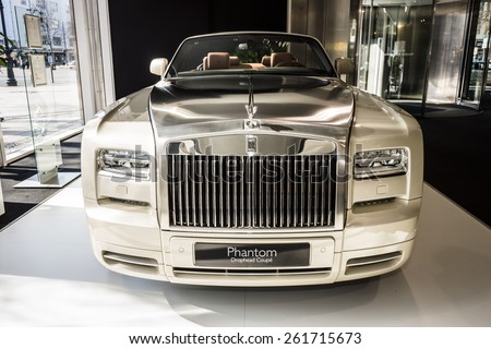 BERLIN - MARCH 08, 2015: Showroom. Luxury car Rolls-Royce Phantom Drophead Coupe. Rolls-Royce Motor Cars Limited global manufacturer of luxury cars. - stock photo
