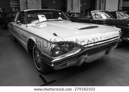 BERLIN - MAY 10, 2015: A large personal luxury car Ford Thunderbird 390 Coupe (second generation), 1964. Black and white. The 28th Berlin-Brandenburg Oldtimer Day - stock photo