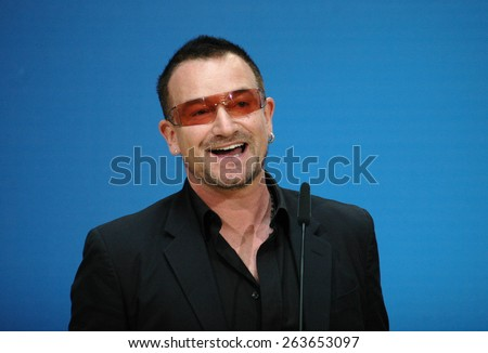 "BERLIN, MAY 14, 2007: Bono (born Paul David Hewson), singer of the Band ""U2"" smiles into the camera at a meeting with politicians of the Social Democratic Party (SPD) in Berlin. - stock photo"