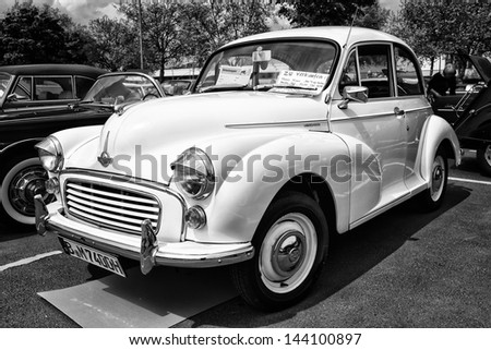 BERLIN - MAY 11: Economy car Morris Minor 1000 (black and white), 26th Oldtimer-Tage Berlin-Brandenburg, May 11, 2013 Berlin, Germany - stock photo