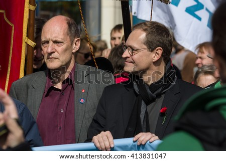 BERLIN - MAY 01, 2016: Governing Mayor of Berlin Michael Mueller (center). Members of trade unions, workers and employees at the demonstration on the occasion of Labour day. - stock photo