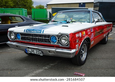 BERLIN - MAY 10, 2015: Muscle car Plymouth GTX in the racing coloring. 28th Berlin-Brandenburg Oldtimer Day - stock photo