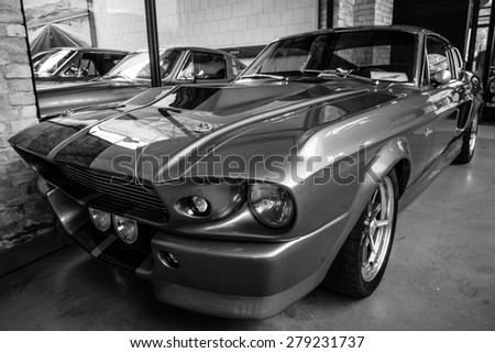 BERLIN - MAY 10, 2015: Shelby GT 500E Super Snake, 1968. Black and white. The Shelby is a higher performance variant of the Ford Mustang. 28th Berlin-Brandenburg Oldtimer Day - stock photo