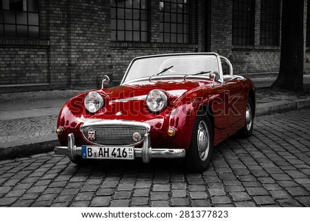 BERLIN - MAY 10, 2015: Sports car Austin-Healey Sprite Mk I. Stylization. Combined toning. 28th Berlin-Brandenburg Oldtimer Day - stock photo