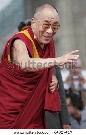 BERLIN - MAY 19 : The Dalai Lama speaks to his supporters  at the Brandenburger Gate in Berlin, 19.05.2008 - stock photo